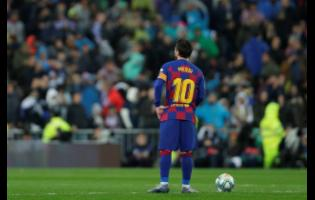 Barcelona's Lionel Messi reacts after Real Madrid's Vinicius Junior scored the opening goal during the Spanish La Liga match between Real Madrid and Barcelona at the Santiago Bernabeu stadium in Madrid, Spain, Sunday, March 1, 2020.
