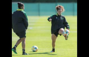 File Dominique Bond-Flasza (left) looks on as Lauren Silver controls the ball during a training session as the Reggae Girlz prepare for the FIFA Women's World Cup in France last year.