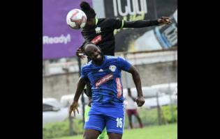 File Mount Pleasant's Francois Swaby (front) goes up for a header ahead of Molynes United's Andrew Peddlar during  a Red Stripe Premier League encounter at the Waterhouse Mini Stadium in October last year.