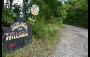 This sign points the direction of Reggae Falls in the community of Hillside, St Thomas.