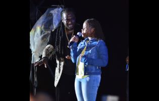 I-Octane performs with his daughter, Octavia, during Rebel Salute at Grizzly's Plantation Cove in St Ann.