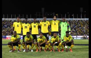 The Reggae Boyz  pose for a team photo before the start of their Concacaf Gold Cup match against Honduras in 2019.