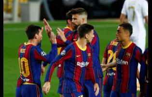 Barcelona players celebrate the opening goal of their team during the Champions League Group G match between FC Barcelona and Ferencvaros at the Camp Nou stadium in Barcelona, Spain, yesterday.