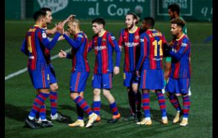 Barcelona's Martin Braithwaite (third left) celebrates after scoring his side's second goal during a Spanish Copa del Rey round of 32 match between Cornella and FC Barcelona at the Nou Municipal stadium in Cornella, Spain, yesterday.
